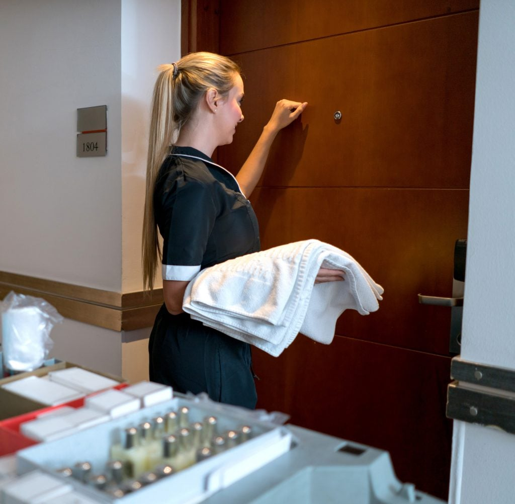 Housekeeper knocking on a door at the hotel